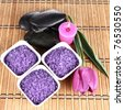 Lavender spa salt, spa stones, a candle and a tulip flower - stock photo