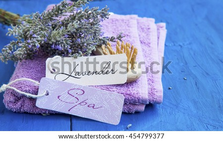 Lavender spa still life with labels on cotton towels and lavender flowers bunch - stock photo