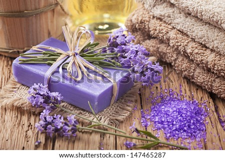 Lavender spa treatment on wooden background - stock photo