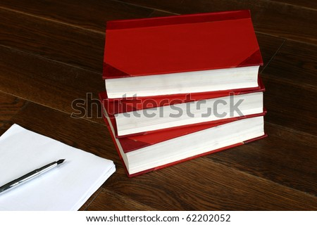 Law books ,pen and paper - stock photo