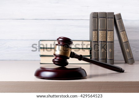 Law concept - Book with wooden judges gavel on table in a courtroom or enforcement office - stock photo