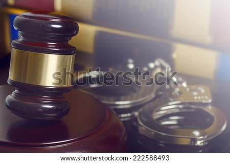 Law concept image - gavel and handcuffs - stock photo
