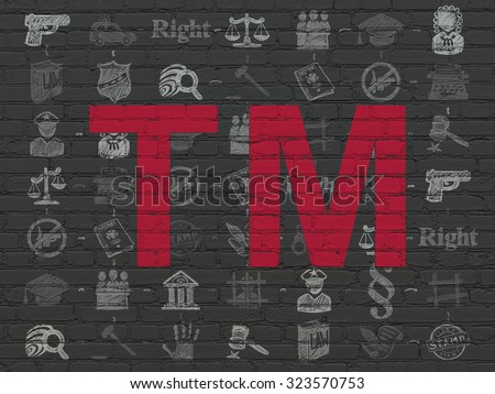 Law concept: Painted red Trademark icon on Black Brick wall background with Scheme Of Hand Drawn Law Icons - stock photo