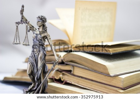 Law concept, statue and books - stock photo