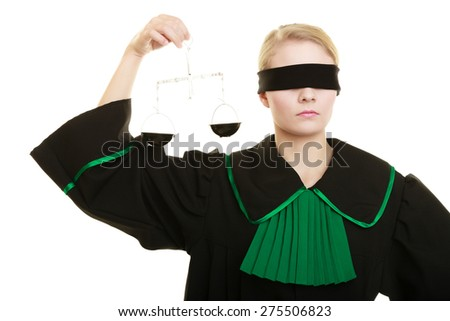 Law court concept. Woman lawyer wearing classic polish black green gown with covered eyes holds scales. Femida - symbol sign of justice. isolated on white - stock photo