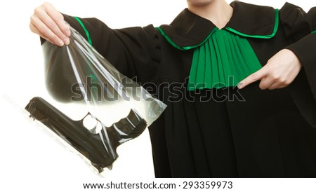 Law court or justice concept. Woman lawyer attorney wearing classic polish black green gown with weapon gun - bag marked evidence for crime. isolated on white - stock photo