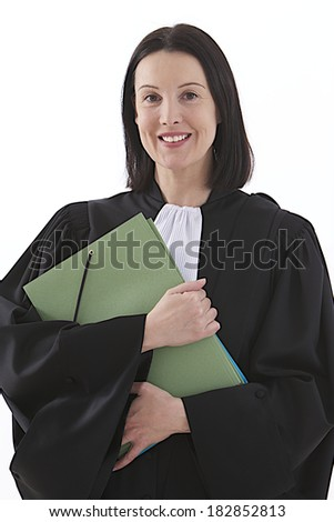 Law court or justice concept. Young woman lawyer attorney wearing classic  French black white  gown with file folder or dossier isolated on white background  - stock photo