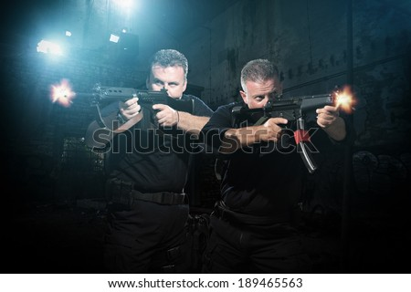 Law enforcement officers special tactics team in action - stock photo