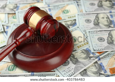 Law gavel on dollars background, closeup - stock photo