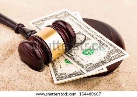 law gavel on sand - stock photo