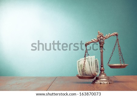 Law scales and cash money on table concept photo - stock photo