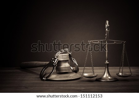 Law scales, judge gavel, handcuff on table. Symbol of justice. Vintage sepia photo - stock photo