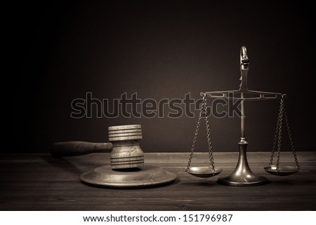 Law scales, judge gavel on table. Symbol of justice. Vintage photo - stock photo