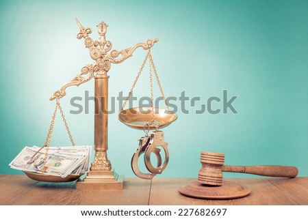 Law scales with thousands dollars cash money and handcuff, wooden judge gavel - stock photo