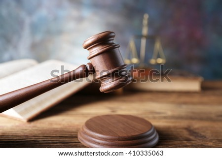 law theme, mallet of the judge, justice scale, hourglass, books, wooden desk - stock photo