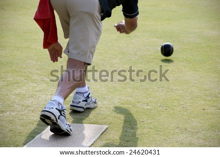Lawn Bowler in Action from behind. - stock photo
