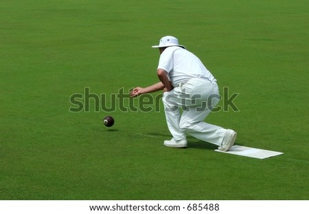lawn bowler releasing bowl - stock photo