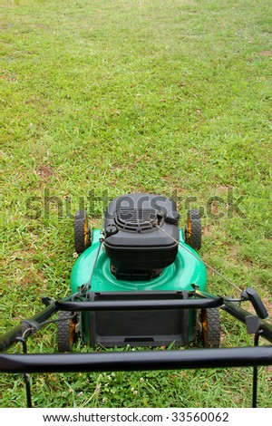 lawn mover on green lawn - stock photo