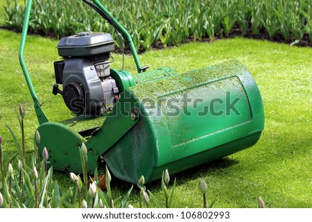 lawn mower in the green - stock photo