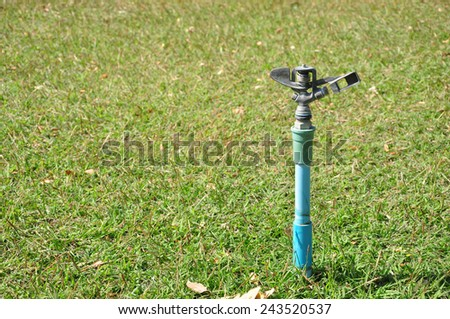 lawn sprinkler head water the grass - stock photo
