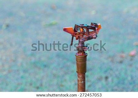 Lawn watering with a sprinkler system. Which last for many years.  - stock photo
