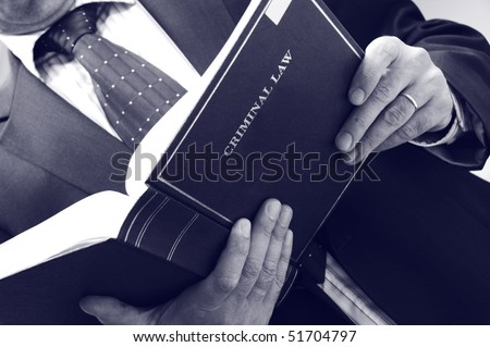lawyer holding criminal law book, law concept , blue toned - stock photo