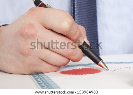 Lawyer, notary signs the documents from our office - stock photo
