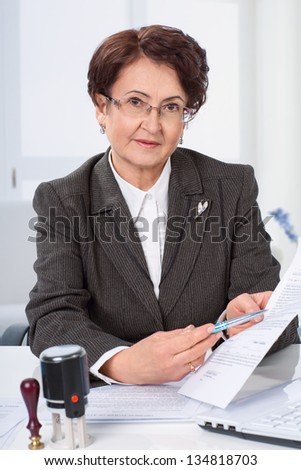 Lawyer or notary public on his workplace with documents - stock photo