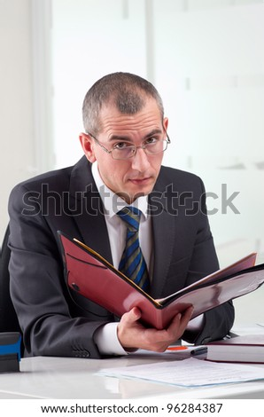 Lawyer or notary public on his workplace with file folder - stock photo