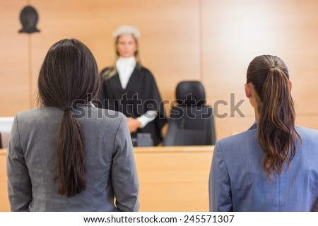 Lawyers listening to the judge in the court room - stock photo