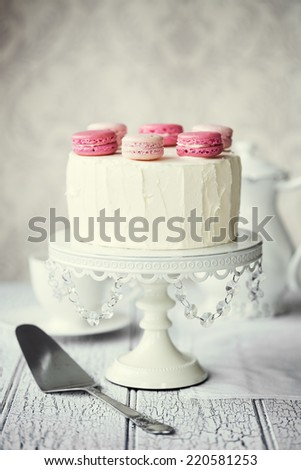 Layer cake decorated with macarons - stock photo