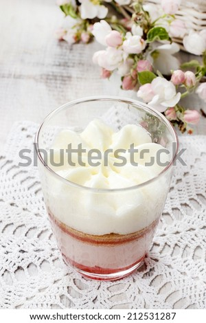 Layer strawberry dessert with whipped cream topping - stock photo