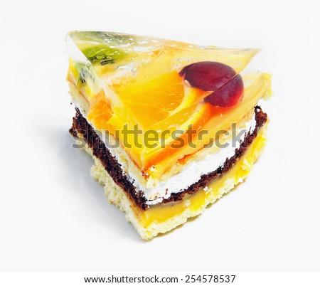 Layered fruit cake with orange, grapes and kiwi - stock photo