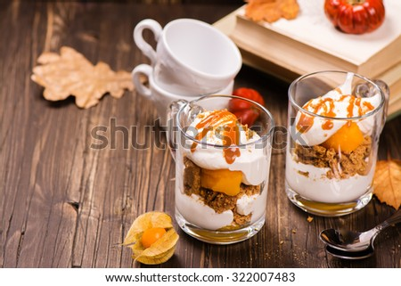 """Layered """"pumpkin pie"""" in a glass cup. Pumpkin tiramissu. Vintage style. Selective focus - stock photo"""