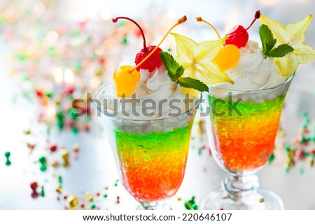 Layered sparkling jelly with cream and fruits for holiday - stock photo