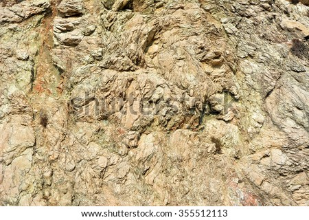 Layers of a copper-rich soil with different stones inside at mountains on Cyprus island - stock photo