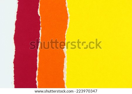 layers of colorful torn paper - stock photo
