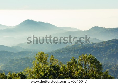 Layers of mountain among the mist and sun light. Natural scenic view from Inthanon national Park, Chaingmia Thailand - stock photo