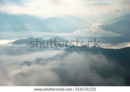 layers of mountain at the sun rise - stock photo