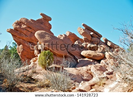Layers of red rocks form a textured scene - stock photo