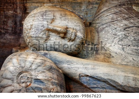 laying Buddha in Polonnaruwa temple - medieval capital of Ceylon,UNESCO World Heritage Site - stock photo