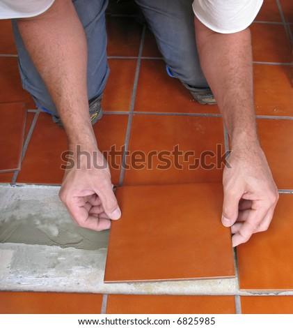 Laying ceramic tile - stock photo