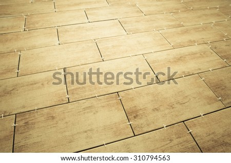 laying ceramic tiles on the floor. selected focus. background - stock photo