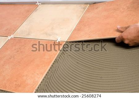 Laying floortiles - stock photo