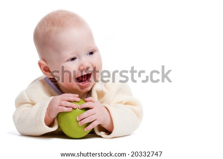 laying little boy portrait with green apple, copy space - stock photo