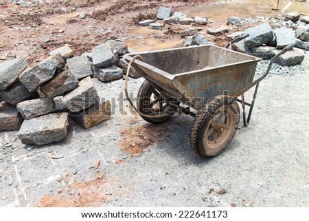 laying of bricks on path way. Bricklayer paving a street. obblestones, pavement construction - stock photo