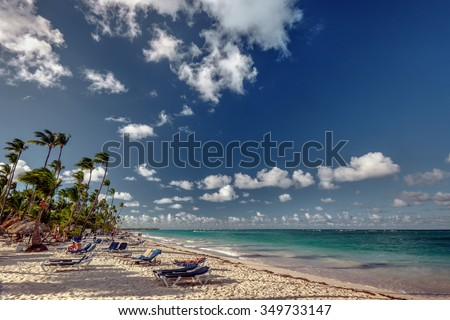 Lazy afternoon, turquoise beach, and palm trees - stock photo