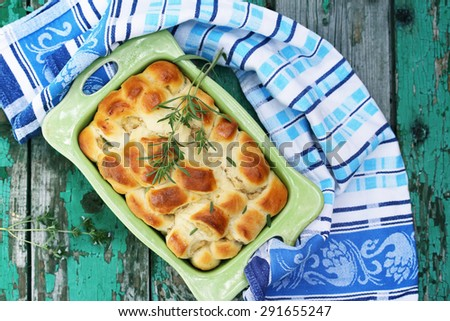 Lazy meat pies in a ceramic green shape - stock photo