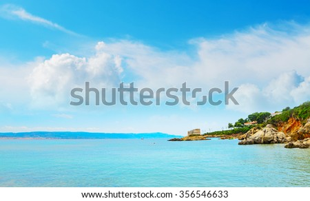 Lazzaretto beach on a cloudy day, Sardinia - stock photo
