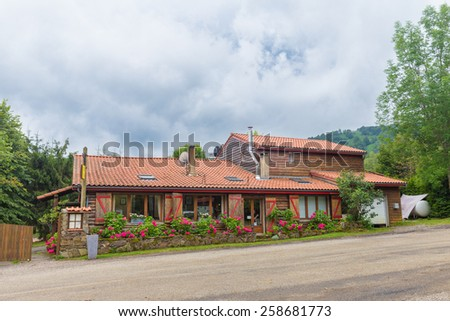 LE BOSC, FRANCE - JULY 25, 2014: Auberge Les Myrtilles in Le Bosc is situated in the Green Valley. In France Auberge is a French word for an inn but is also sometimes used to refer to a restaurant. - stock photo